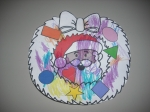 Shape wreath that Emily colored and pasted the shapes on